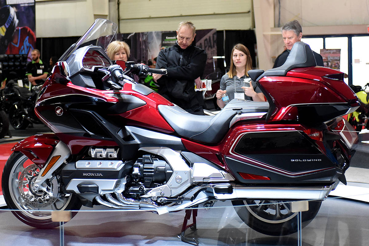 Spectators check out a Honda Goldwing during the Vancouver Motorcycle Show, held Friday to Sunday at Tradex in Abbotsford. The event featured the latest gear, demonstrations, stunt show and a brand new lineup of 2018 motorcycles, ATVs and scooters. (John Morrow/Abbotsford News)